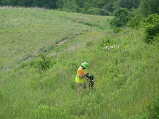 Person Monitoring Landfill in Caution Jacket