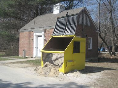 Sand Pouring Out of a Dumpster