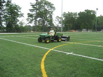 Driving on Field with Green Cart